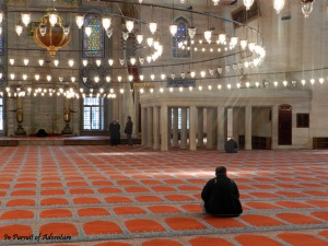 A Glimpse of Istanbul. A Man at Prayer at the Blue Mosque