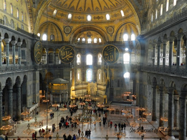 View of the inside of the Hagia Sophia, you can see the mix of Christianity and Islam with the decorations and the remaining mosaics