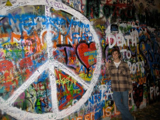 Alex at the John Lennon Wall