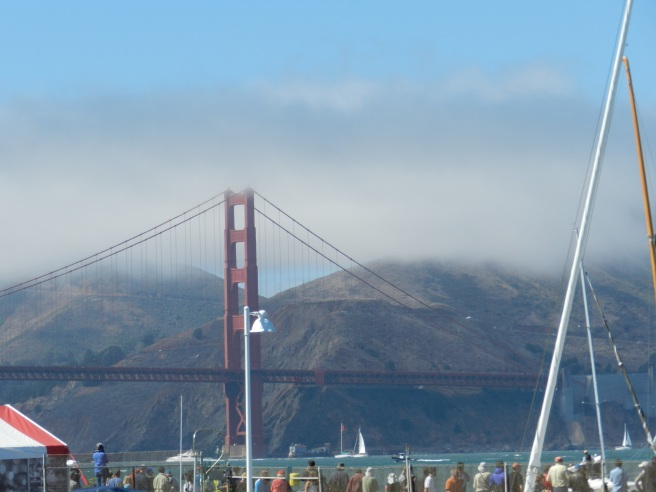 I love the Golden Gate Bridge especially when its being mysterious and all covered with fog and there is fog no where else.