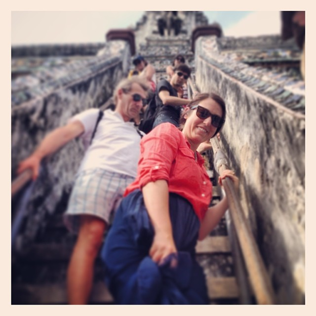 Ashley Climbing down Wat Arun